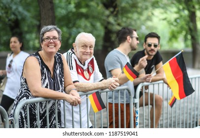 New York City, NY - September 15, 2018: The 61st German-American Steuben Parade brought out thousands of spectators wearing traditional German clothing, waving German flags and watching the parade.