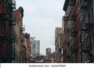 New York City, NY / United States of America - January 6 2020: streetscape of West Village on Manhattan Island. Back street with fire escape stairs.