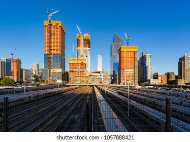 New York City, NY, USA - June 3, 2017: The Hudson Yards construction site with railway tracks. Already finished is the 10 Hudson Yards (South Tower) skyscraper. Midtown, Manhattan