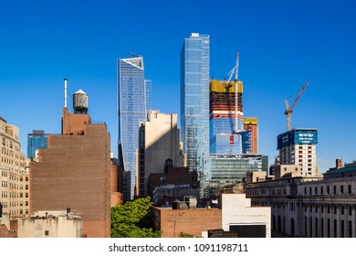 New York City, NY, USA - June 4, 2017: The Hudson Yards construction site with 30 Hudson Yards under construction and the completed 10 Hudson Yards and Eugene skyscrapers.  Midtown, Manhattan