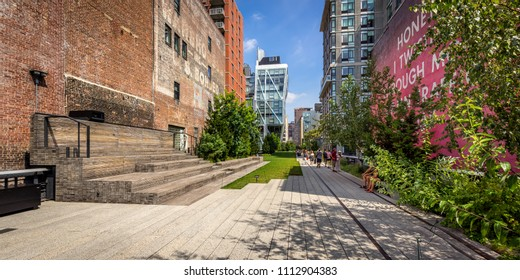 New York City, NY, USA - September 2, 2014: The High Line promenade in afternoon light surrounded by modern and old buildings in Chelsea. The aerial greenway is also known as Highline