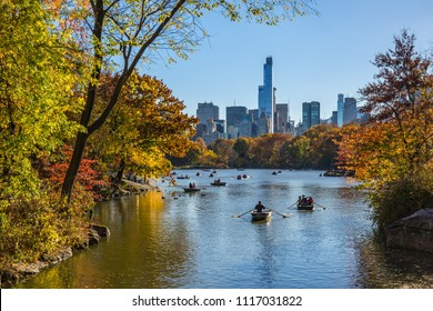 New York City, NY, USA - November 08, 2015: The Lake in Central Park on a late afternoon in Fall with row boats. One57 skyscraper rises in the background. Manhattan, Midtown