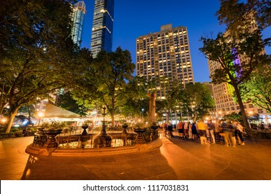 New York City, NY, USA - June 17, 2016: Madison Square Park and fountain at twilight in Summer. Flatiron District, Midtown, Manhattan