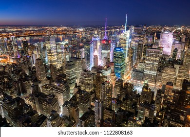 New York City, NY, USA - Mach 11 11, 2018: Midtown Manhattan skyscrapers illuminated at night (Times Square). The view includes Bank of America Tower, Rockefeller Center and Brynat Park