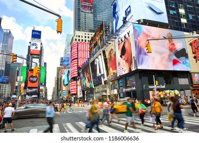 NEW YORK CITY, NY, USA - SEPTEMBER 15, 2018: Times Square crowds and traffic with lots of animated LED billboard advertising