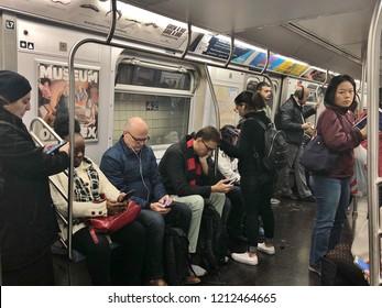 New York City, NY/ USA: 10-24-18-New York City People Commuting Subway Underground Transit Diverse New Yorkers NYC Urban Life