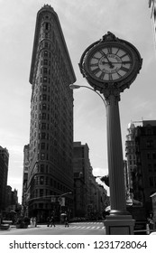 New York City, NY / USA - September 2012: Black and white capture of the Flatiron Building and a clock in 5th Ave