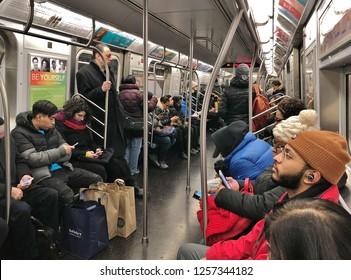 New York City, NY/ USA- 12-12-18: NYC Subway Train Commuter People Riding Subway Car to Work Crowded City Train MTA