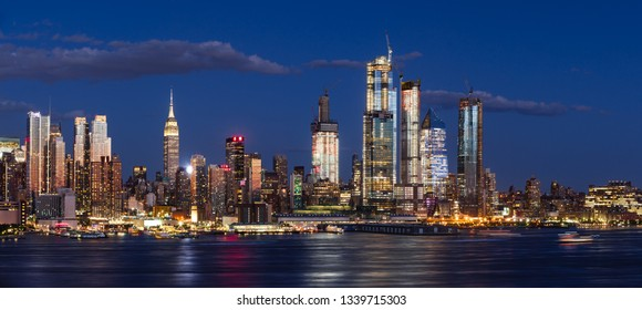 New York City, NY, USA - June 14, 2018: Hudson Yards skyscrapers under construction in Midtown West Manhattan at dusk. Luxury apartments and office buildings redifining the New York City skyline
