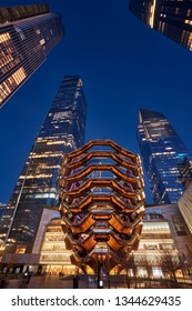 New York City, NY, USA - March 19, 2019: The Vessel, also known as the Hudson Yards Staircase (designed by architect Thomas Heatherwick) at dusk. Manhattan
