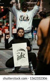New York City, NY / USA - April 7 2019: Nipsey Hussle Activists and Supporters in Times Square, NYC