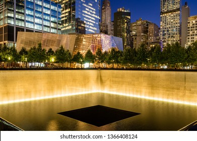 New York City, NY, USA - October 10, 2017: The North Reflecting Pool illuminated at twilight with view of the 9/11 Memorial & Museum. Lower Manhattan