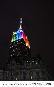 NEW YORK CITY, NY / USA - JUNE 28, 2015: The Empire State Building glows rainbow colors in honor of NYC Pride Week celebration
