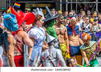 New York City, NY, USA - 06/30/2019 : Group wearing Wizard of Oz costumes posing surrounded by thousands of people wearing colorful costumes attending the World Pride March in NYC for LGBTQ+ rights.