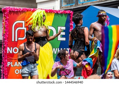 New York City, NY, USA - 06/30/2019 : Group of people dancing on a float amongst thousands of people wearing colorful costumes attending the World Pride March in NYC for LGBTQ+ rights.