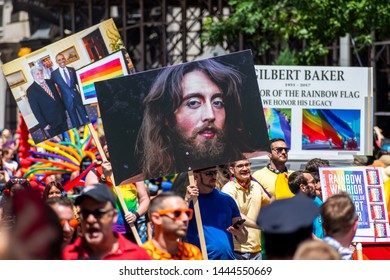 New York City, NY, USA - 06/30/2019 : Thousands of people wearing colorful costumes and holding up signs attending the World Pride March in NYC for LGBTQ+ rights.