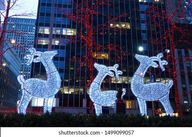 New York City, NY, USA - December 22, 2015: Christmas decorations at Rockefeller Center (view from 6th Avenue and W 48th Street).