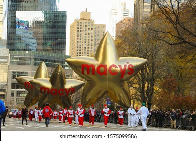 New York City, NY, USA- November 28,2019. The Macy's stars float down Central Park South in the 93 annual Macy's Thanksgiving Day Parade.