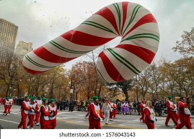 New York City, NY, USA- November 28, 2019: A candy cane balloon floats down Central Park South during the 93 annual Macy's Thanksgiving Day Parade.