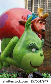 New York City, NY, USA- November 28, 2019: The Grinch balloon flies during the Macy's Thanksgiving Day Parade.