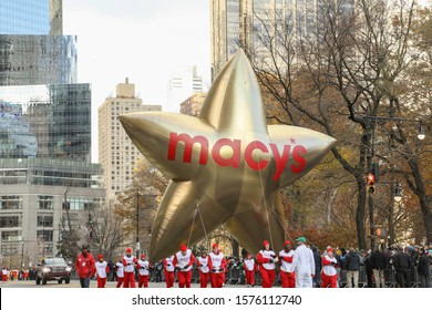 New York City, NY, USA- November 28, 2019: A gold Macy's star balloon floats down Central Park South during the Macy's Thanksgiving Day Parade.