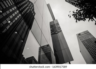 New York City, NY / USA - October, 2007: Black and white capture of the MoMA facade. Low angle.
