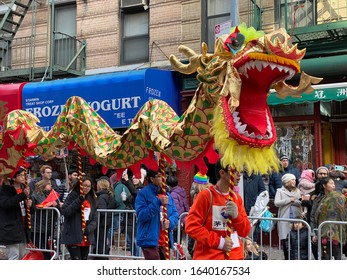 New York City, NY, USA- February 9, 2020: A Chinese dragon parades down Mott Street during the annual Chinese New Year Parade in New York City's Chinatown.