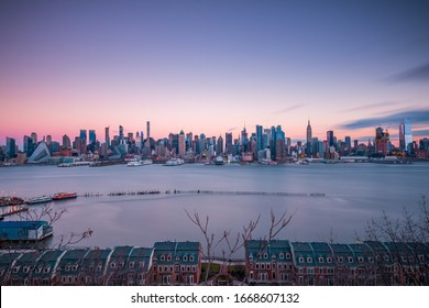 NEW YORK CITY, NY, USA - JANUARY 26, 2017: Panoramic view of Midtown Manhattan skyline at sunset from Weehawken, New Jersey on January 26, 2017.