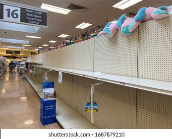 New York City, NY, USA- March 30,2020: Shelves which normally stock paper towels are completely empty due to panic buying caused by Covid-19 virus pandemic.
