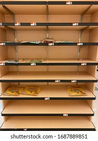 New York City, NY, USA- March 30, 2020: Grocery store shelves normally filled with food are bare, as a result of covid-19 virus pandemic.