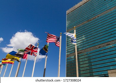 New York City, NY / USA - July 7 2010: United Nations building with flags of diverse nations waving in front of it.