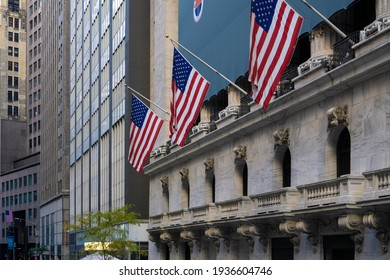 New York City, NY, USA - November 8 2020: New York Wall street. American flags hanging from the New York Stock Exchange Building