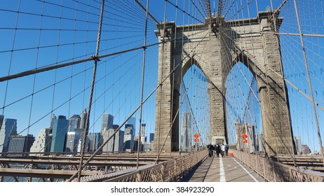New York City, NY, USA - February 18, 2016: Sunny day on famous Brooklyn bridge in New York City. Mobile photo.