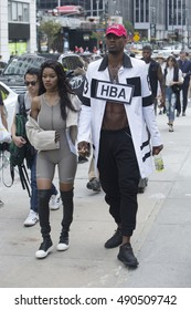 New York City, NY, USA - September 11, 2016: Teyana Taylor and Iman Shumpert walk in front of the Skylight at Moynihan Station on 33rd Street during New York Fashion Week SS17 in New York City.