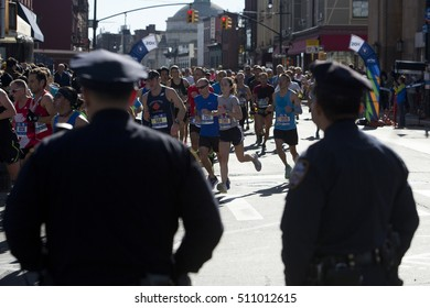 New York City, NY, USA - November 6, 2016: A group of people run in Greenpoint, Brooklyn during the New York City Marathon 2016 in New York City.