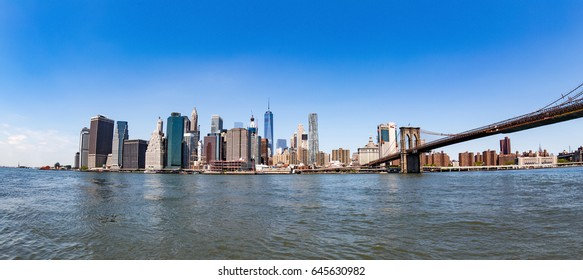 New York City, NY, USA - July 20, 2016: View on Brooklyn bridge and Manhattan from Brooklyn Bridge Park in New York City.