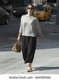 New York City, NY, USA - June 20, 2017: A woman walks in midtown New York City.