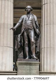 New York City, NY USA - 05/11/2015 -  George Washington Statue on Wall Street