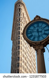 New York City, NY/United States-05/18/2015: The Flatiron building with the 5th Avenue clock.