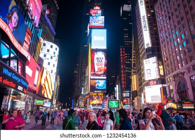 New York City, NY/United States-05/18/2015: Hordes of tourists flock to Times Square at night.