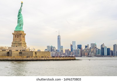 New York City, NY/USA - Dec 30th 2014: Lady Liberty Statue with Lower  Manhattan Background