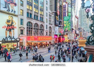 New York City, NY/USA - Jan 1st 2015: New Year's Day in Times Square, Manhattan. Streets Full of People Celebrating in a  Festive Atmosphere. Avenue Full of Multicolored LED Screens and Signs.