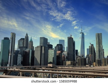 New York City, NY/USA - October 26th 2019: View from walking level of the Brooklyn Bridge on skyscrapers and World Trade Center in downtown Manhattan.