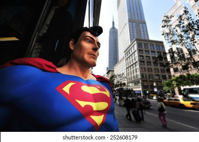 NEW YORK CITY - OCT 10 2009:Superman and the Empire State Building in New York City.Superman is an American cultural icon and has been labeled as the greatest comic book hero of all time by IGN