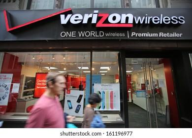NEW YORK CITY - OCT 17:  Pedestrians walk past a Verizon Wireless retail outlet in Manhattan on Thursday, October 17, 2013.