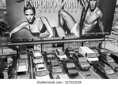 NEW YORK CITY- OCT 2, 2009: Billboard featuring Victoria and David Beckham in an ad for Emporio Armani underwear. Located in the city's trendy Meatpacking District. Black and white image.