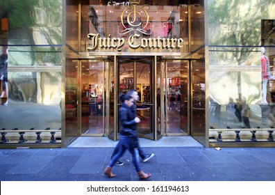 NEW YORK CITY - OCT 20, 2013: Pedestrians walk past a Juicy Couture women's clothing store on 5th Avenue in Manhattan on Sunday, October 20, 2013.