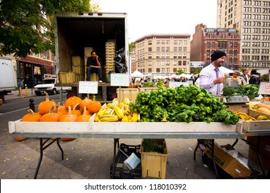 NEW YORK CITY - OCT 26: Produce stand at Union Square Greenmarket in NYC on Oct. 26, 2012. This world famous farmers' market began in 1976 and has grown to 140 farmers during peak season.
