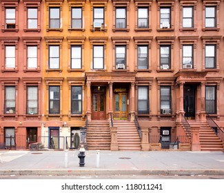 NEW YORK CITY - OCT 26: Row of 1880's historic NYC brownstones in Harlem on Oct 26, 2012. This historic neighborhood in Manhattan is a major African-American residential, cultural and business center