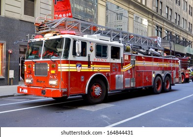 NEW YORK CITY OCT 27: FDNY Tower Ladder 24 truck in Manhattan on Otc 27, 2013. FDNY is the largest combined Fire and EMS provider in the world